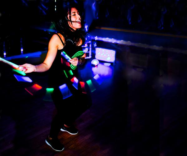 Clubbercise is held in a dark studio with glow-sticks and disco lights