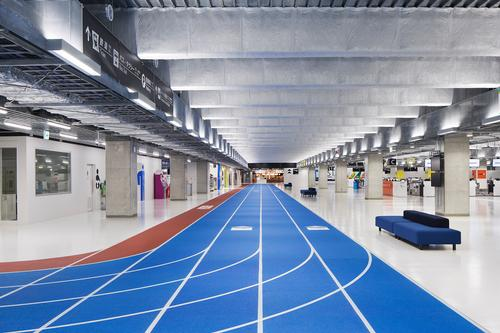 Tokyo-based creative lab Party led the new innovative airport project, which sees colour-coded running lanes help passengers navigate the terminal / Kenta Hasegawa