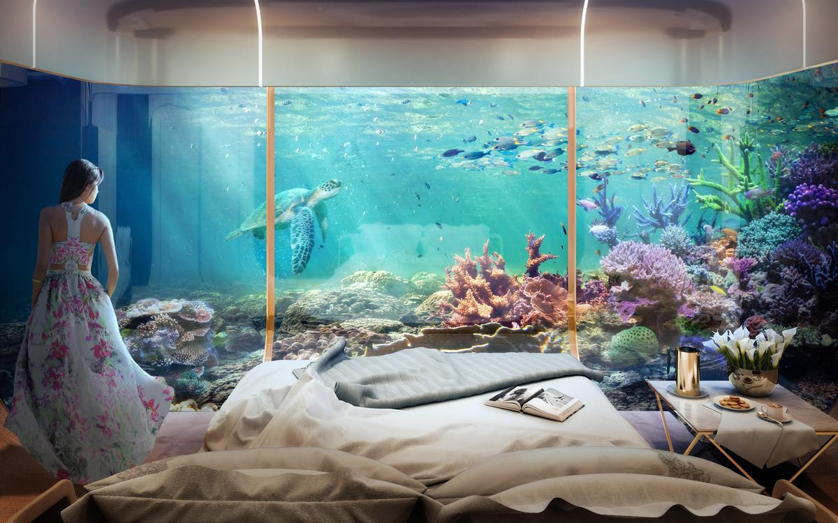 Floor-to-ceiling glass windows allowing a clear view of the sea life / Kleindienst Group