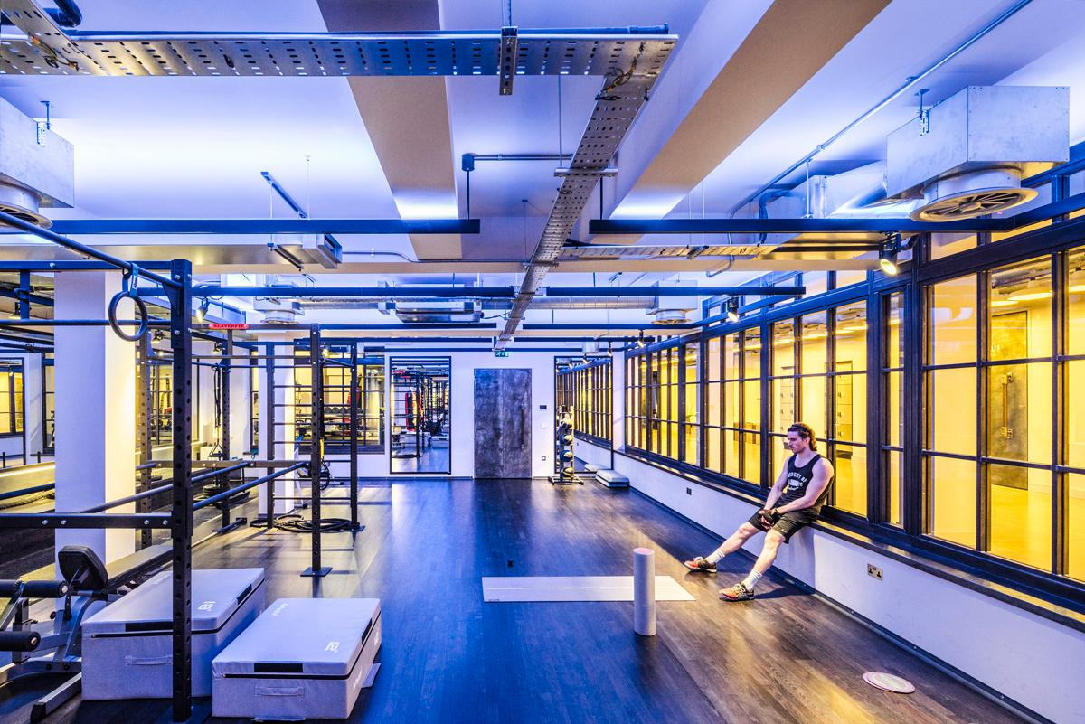 The gym, operated by boutique fitness studio Core Collective, features exposed concrete and masonry / WG+P