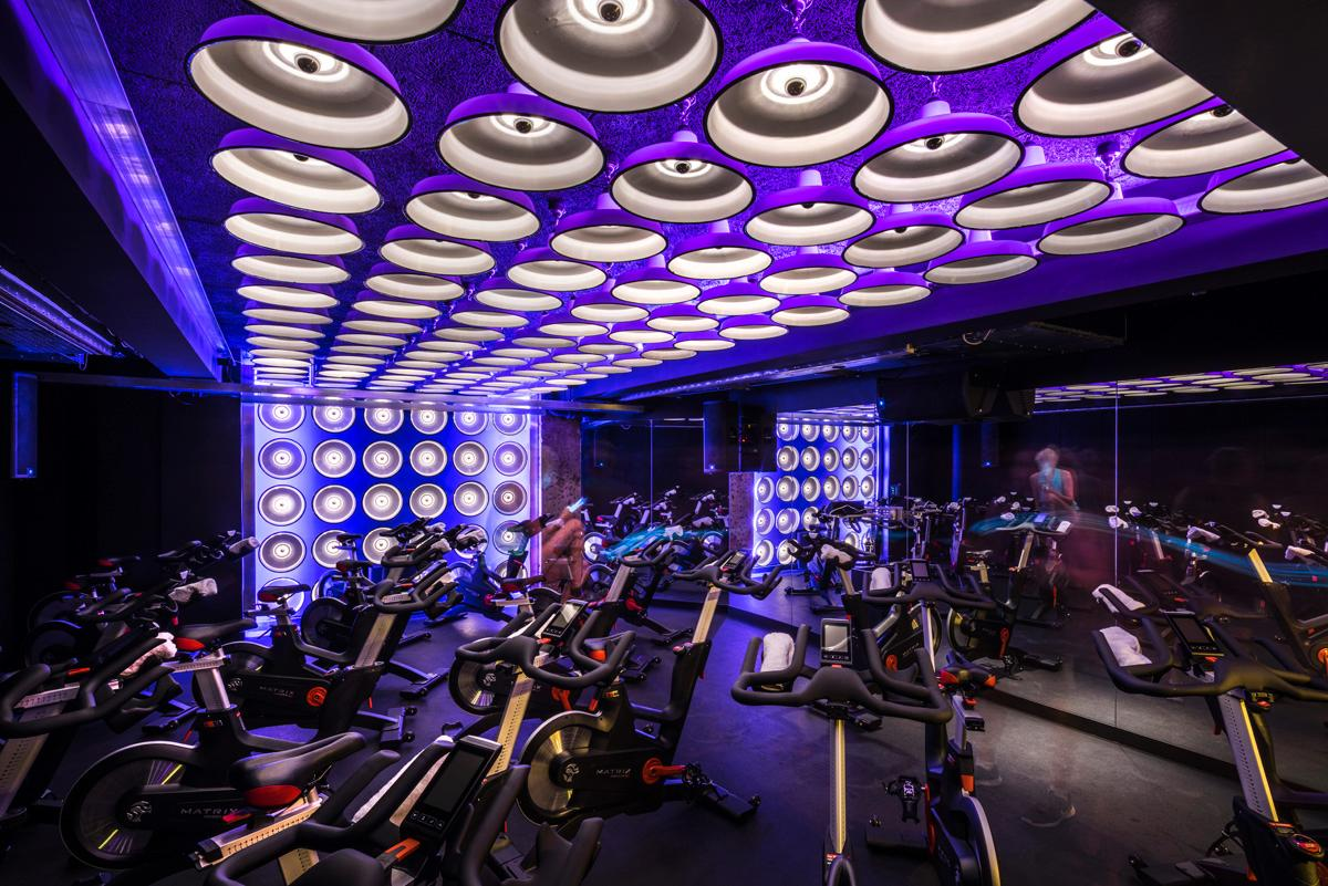 Colour changing LED lighting creates low, warm and energised space for spinning and expanded, cool and focused space for yoga / WG+P