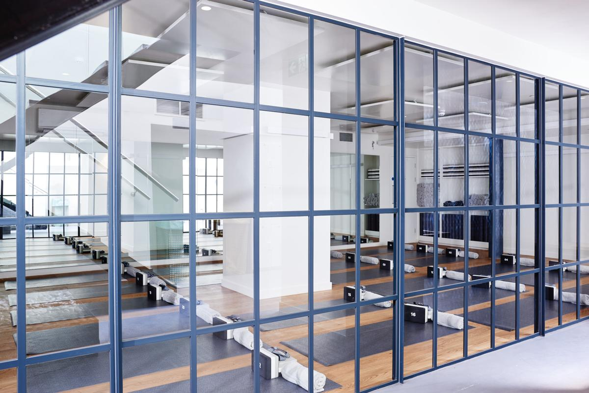 The studio is split over two floors and features specialist training rooms for the three classes on offer / Another_Space
