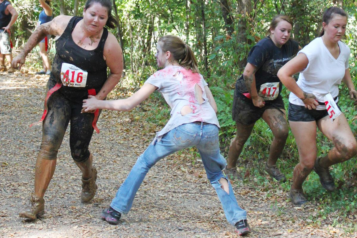 Zombie-themed running events aimed at families have become increasingly popular in recent years / Val Lawless / Shutterstock.com