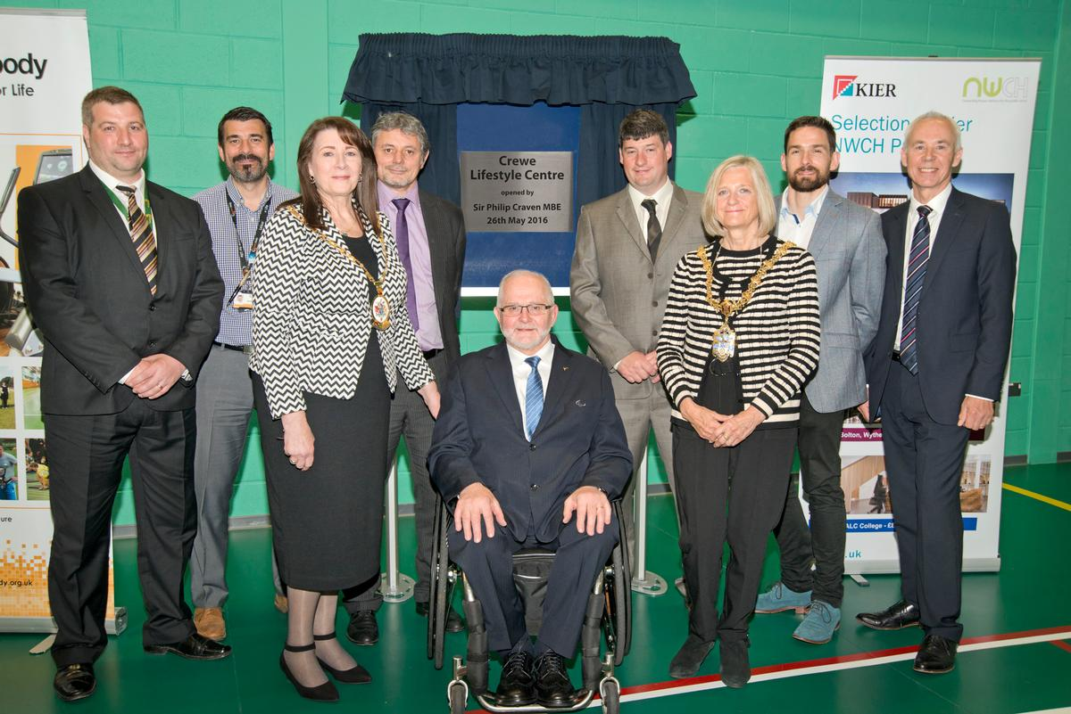 Sir Philip Craven (centre) with councillors and volunteers at the launch