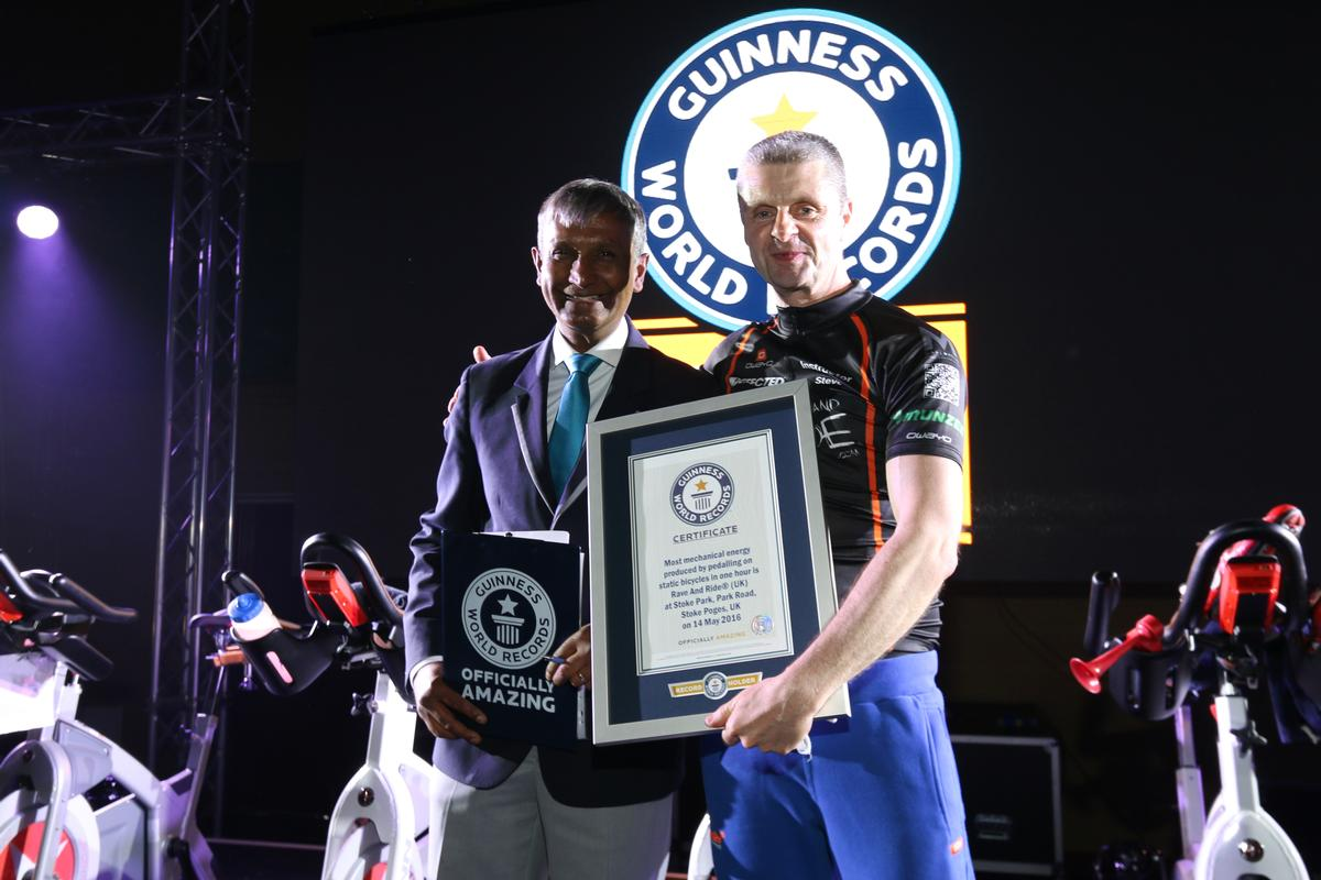 Rave & Ride organiser Steven Smith receives confirmation of the records from adjudicator Pravin Patel