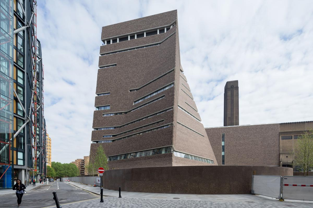 The new Tate Modern features a bold, pyramid-like extension called the Switch House, created by Herzog and de Meuron / Iwan Baan