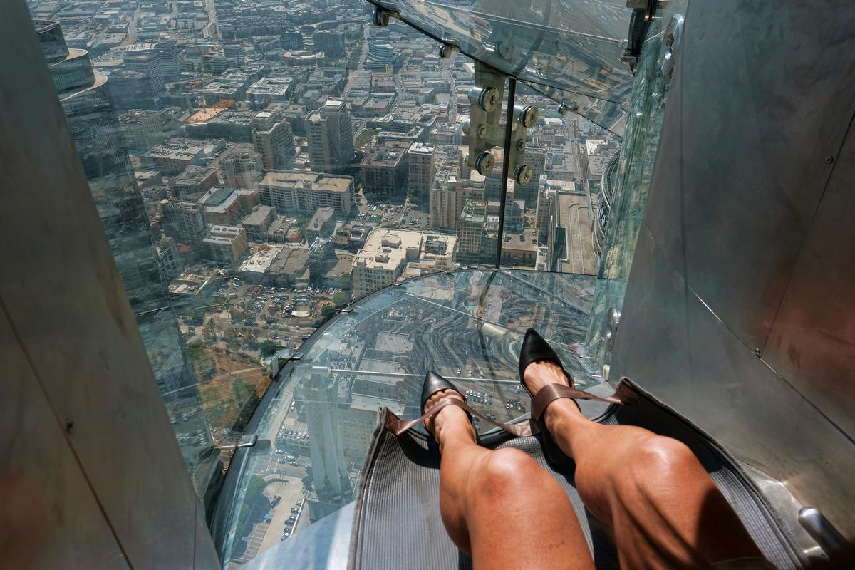 The 45ft long Skyslide links the 70th and 69th floors of LA's Bank Tower / Richard Vogel/PA Images