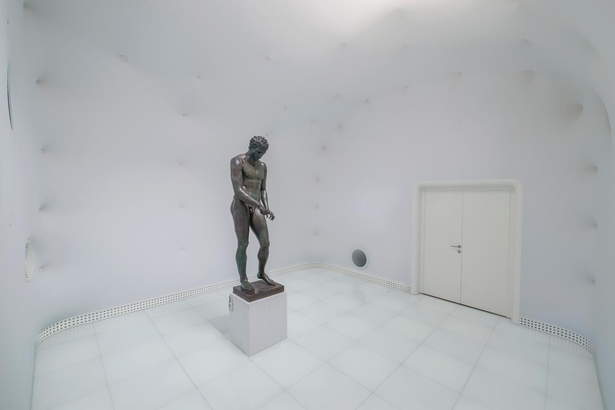 The white room by architect Vanja Ilic is the culmination of the museum experience, with a completely white room showcasing Apoxyomenos / Museum of Apoxyomenos