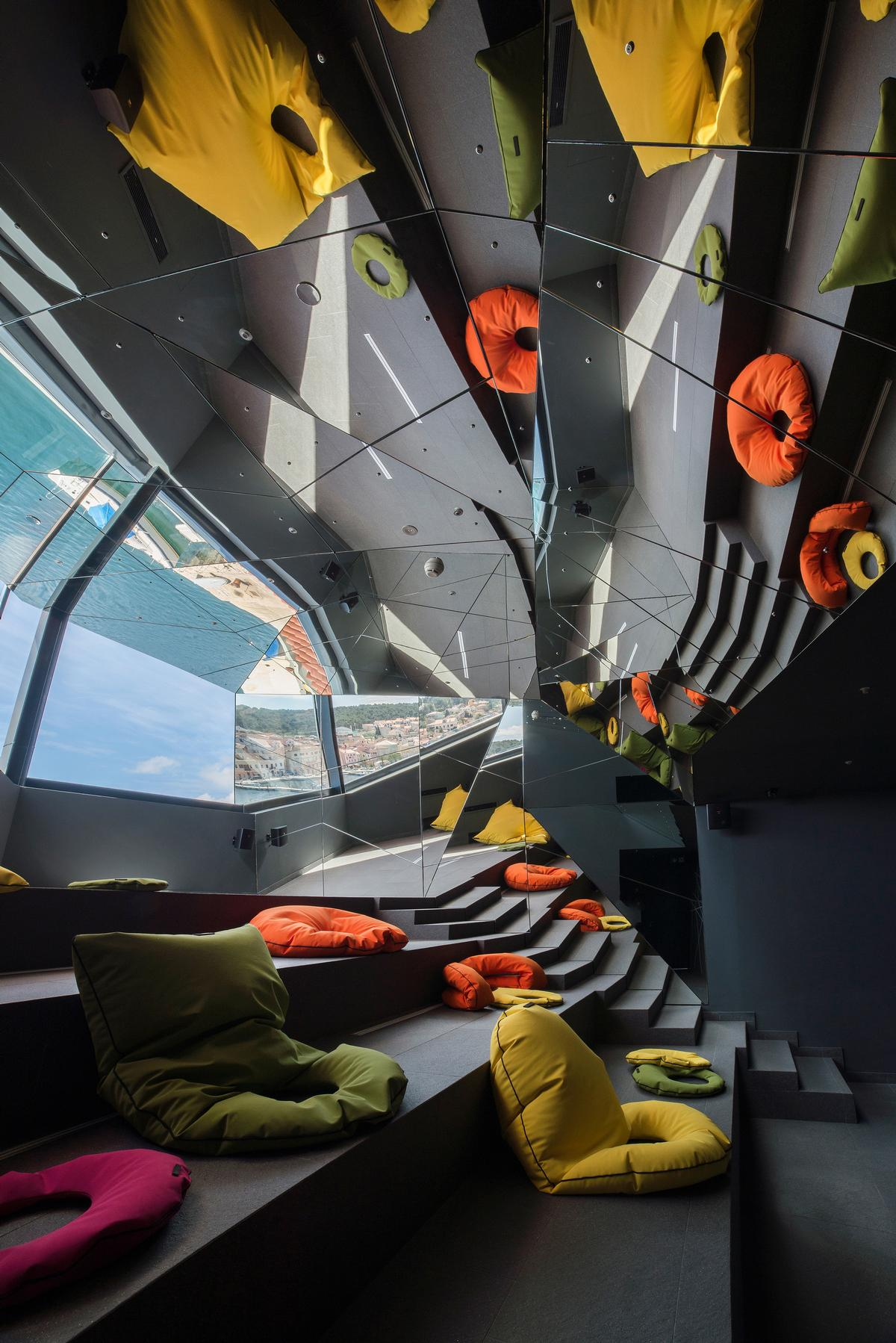 """After viewing the statue, visitors leave the room, entering a final space known as """"the kaleidoscope room' / Museum of Apoxyomenos"""