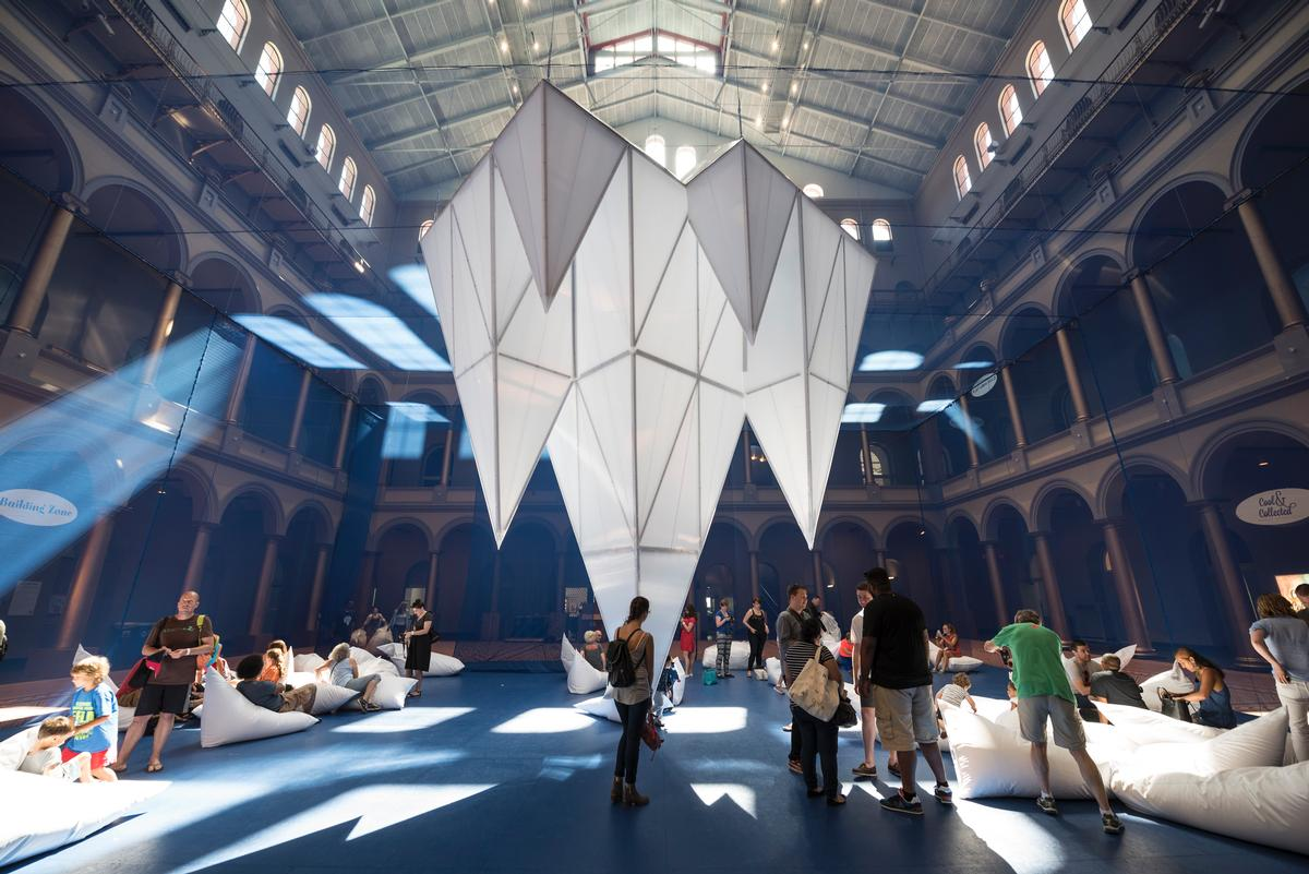 The installation at the National Building Museum makes visitors feel as though they are walking through an underwater world of ice fields / Timothy Schenck
