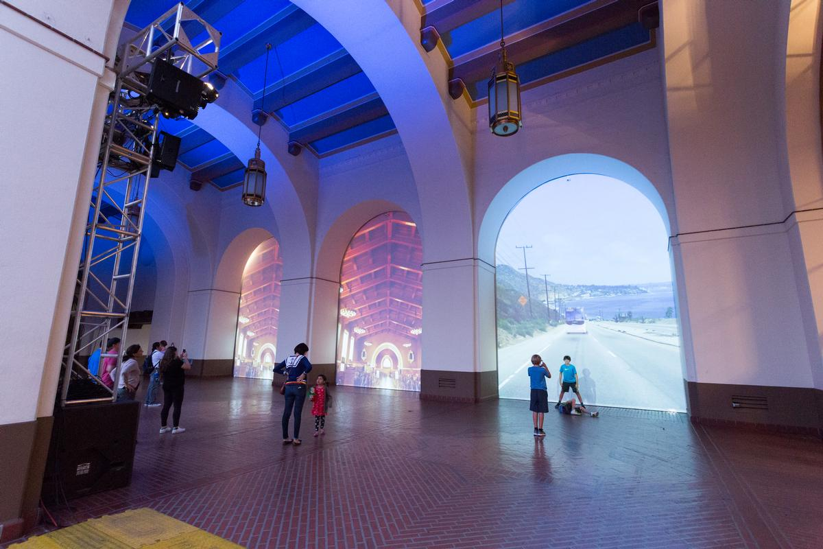 A series of giant projection screens were also installed within the archways of the arcade leading to the plaza / David Green