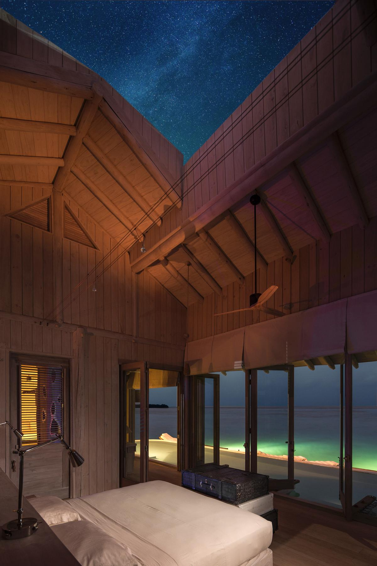 The bedroom roofs at the Soneva Javi resort can be opened at the touch of a button to reveal the night sky / Richard Waite