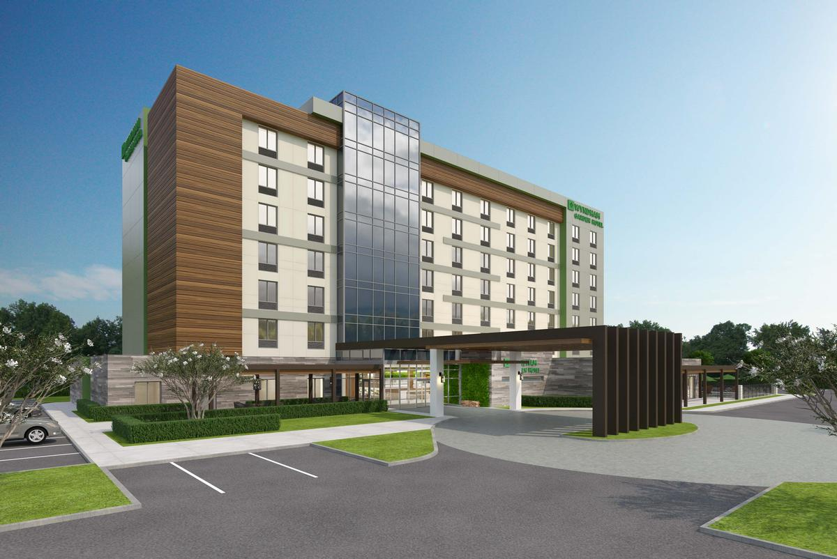 Hospitality giant wyndham designs prototype for low cost for Green hotel design