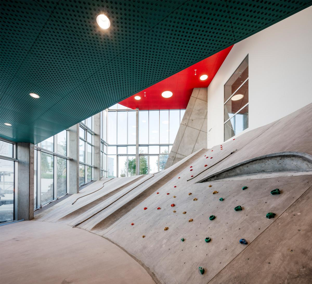 Slides, fireman's poles, labyrinths, nets and climbing walls provide a means of navigating around the Ku.Be / Adam Mørk