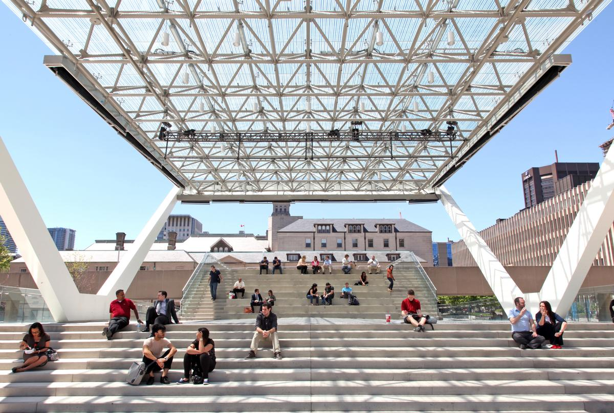 A versatile stage structure under a glazed roof canopy sits at the heart of Nathan Phillips Square in Toronto / Perkins + Will