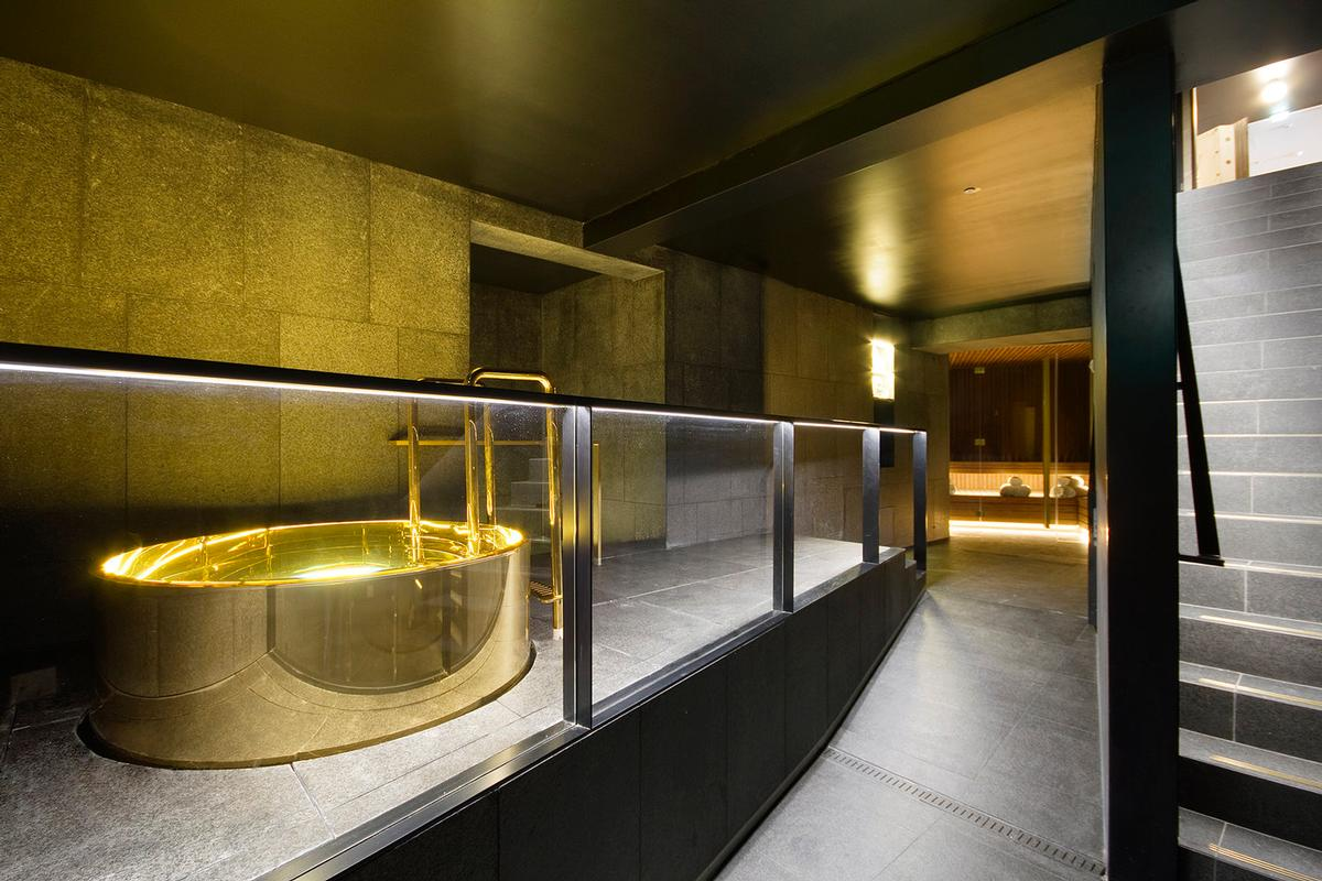 w amsterdam hotel opens black and gold bank vault spa
