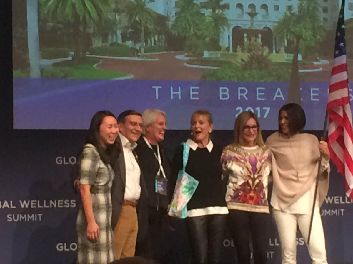 Susie Ellis, centre, celebrates with representatives from The Breakers as well as the three co-chairs for next year's event