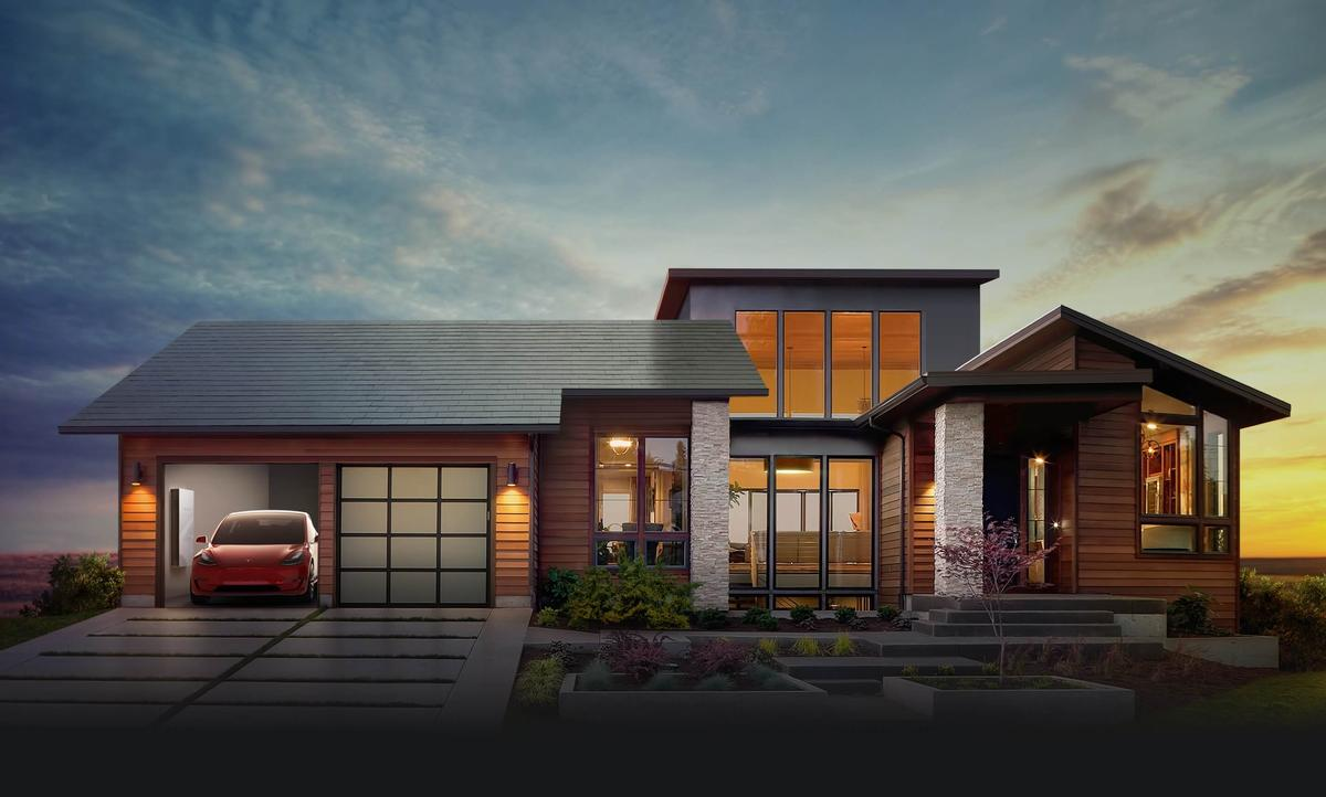 Each solar roof tile uses coloured film to disguise the presence of fully integrated solar cells / Tesla