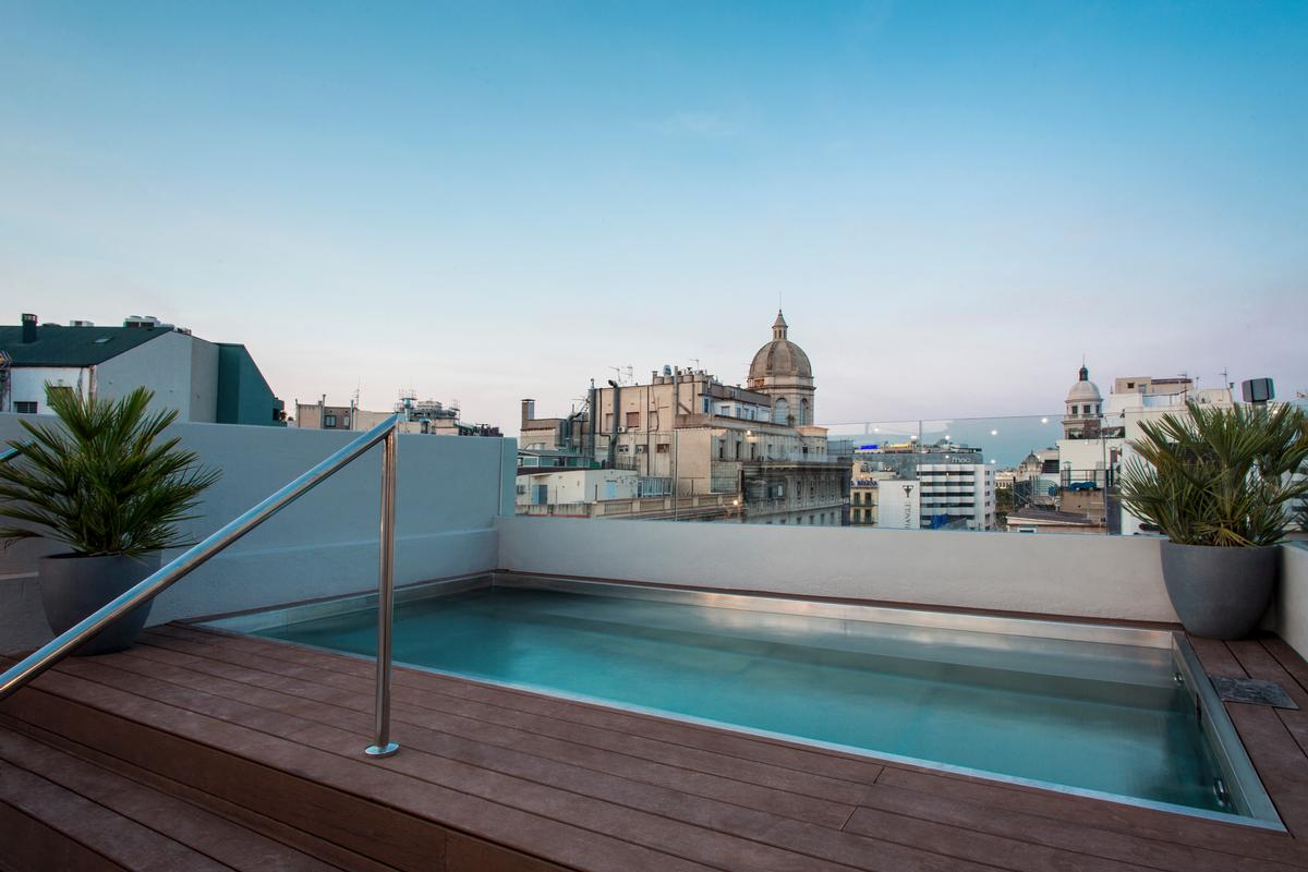 A rooftop offers a pool with a panoramic view over the city / Midmost Hotel
