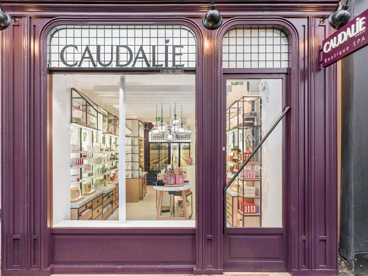 Inspired by the founders' family vineyard and chateau in Bordeaux, the Seoul spa's facade is covered with a combination of fragrant cedar wood and concrete painted in Caudalie's signature deep purple colour