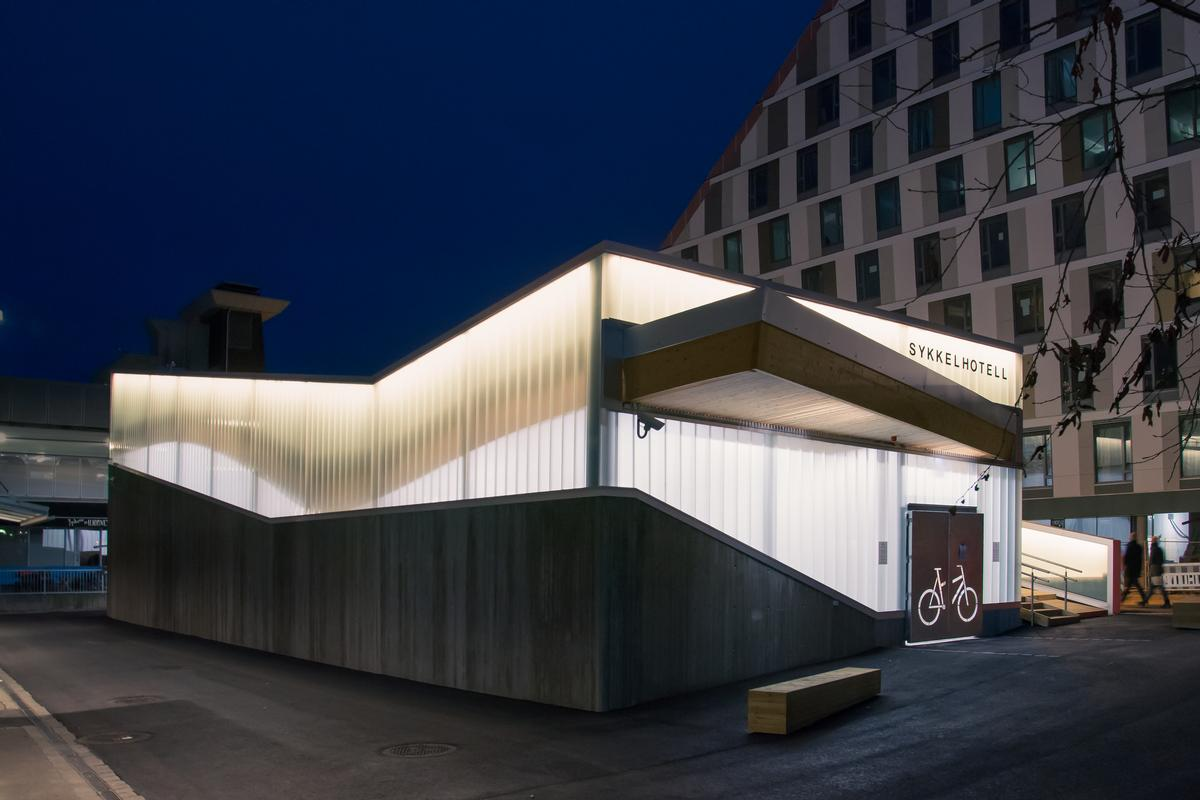 The hotel glows at night, creating an atmospheric local landmark / Ibrahim Elhayawan