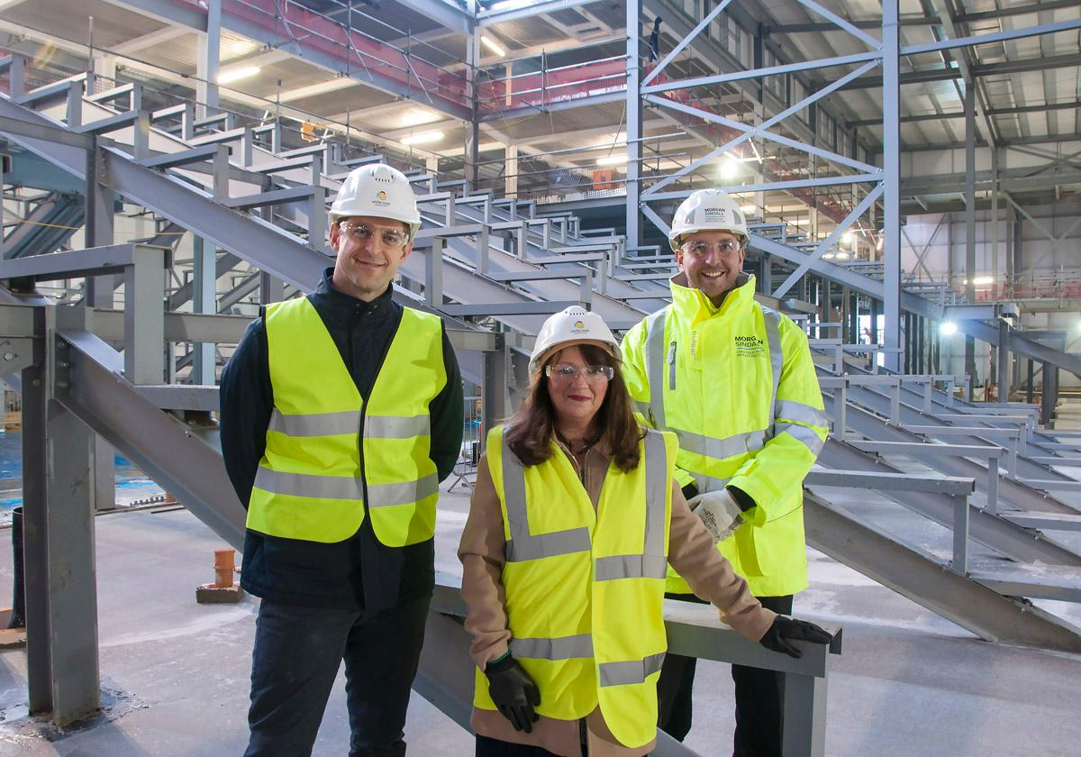 Rob Jewell of Land Securities, councillor Kim Groves and Peter Finegan of Morgan Sindall at the topping out ceremony