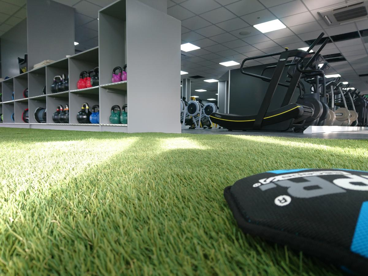 The gym has astro turf flooring and has been kitted out with Technogym equipment