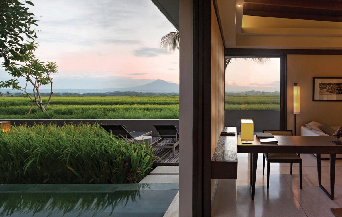 The resort's facilities include an infinity pool, gymnasium, library, spa, helipad, and two gourmet restaurants / Soori Bali