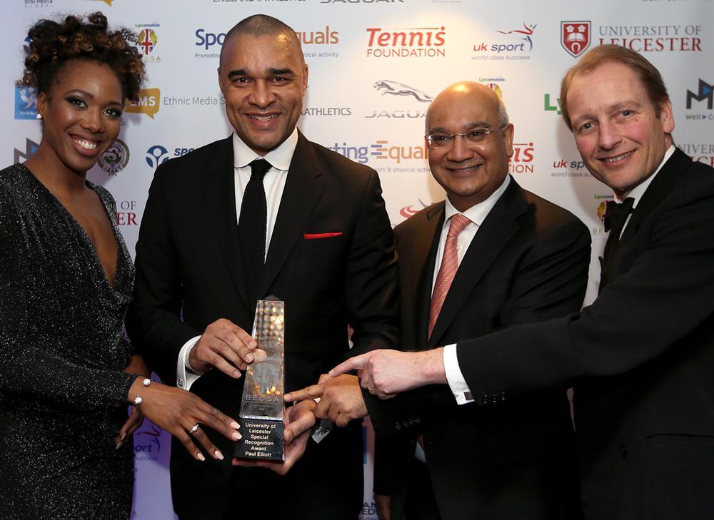 Keith Vaz MP (centre right) hands an award to Paul Elliott