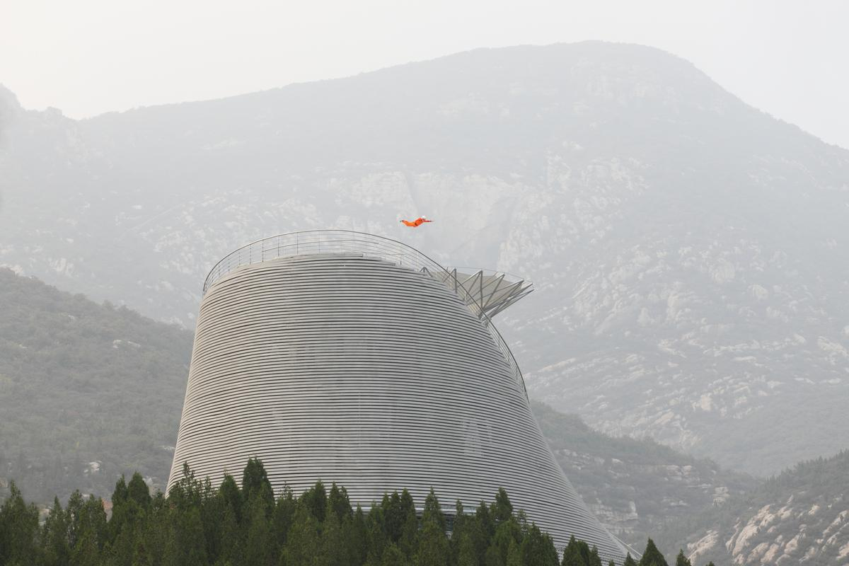 The wind tunnel, developed by manufacturer Aerodium, blasts the monks into the sky / Ansis Starks