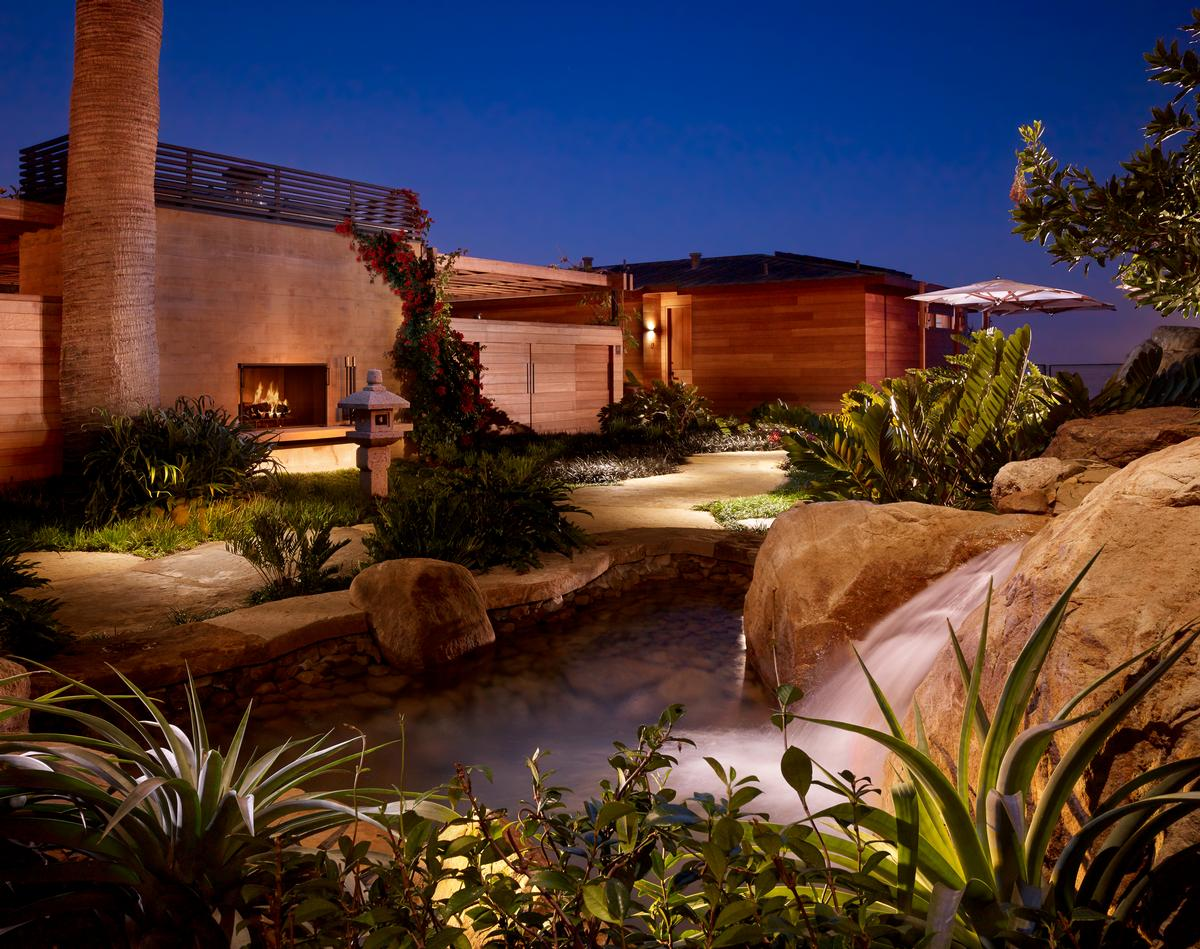 A lush garden and an open courtyard feature at the property / Barbara Kent