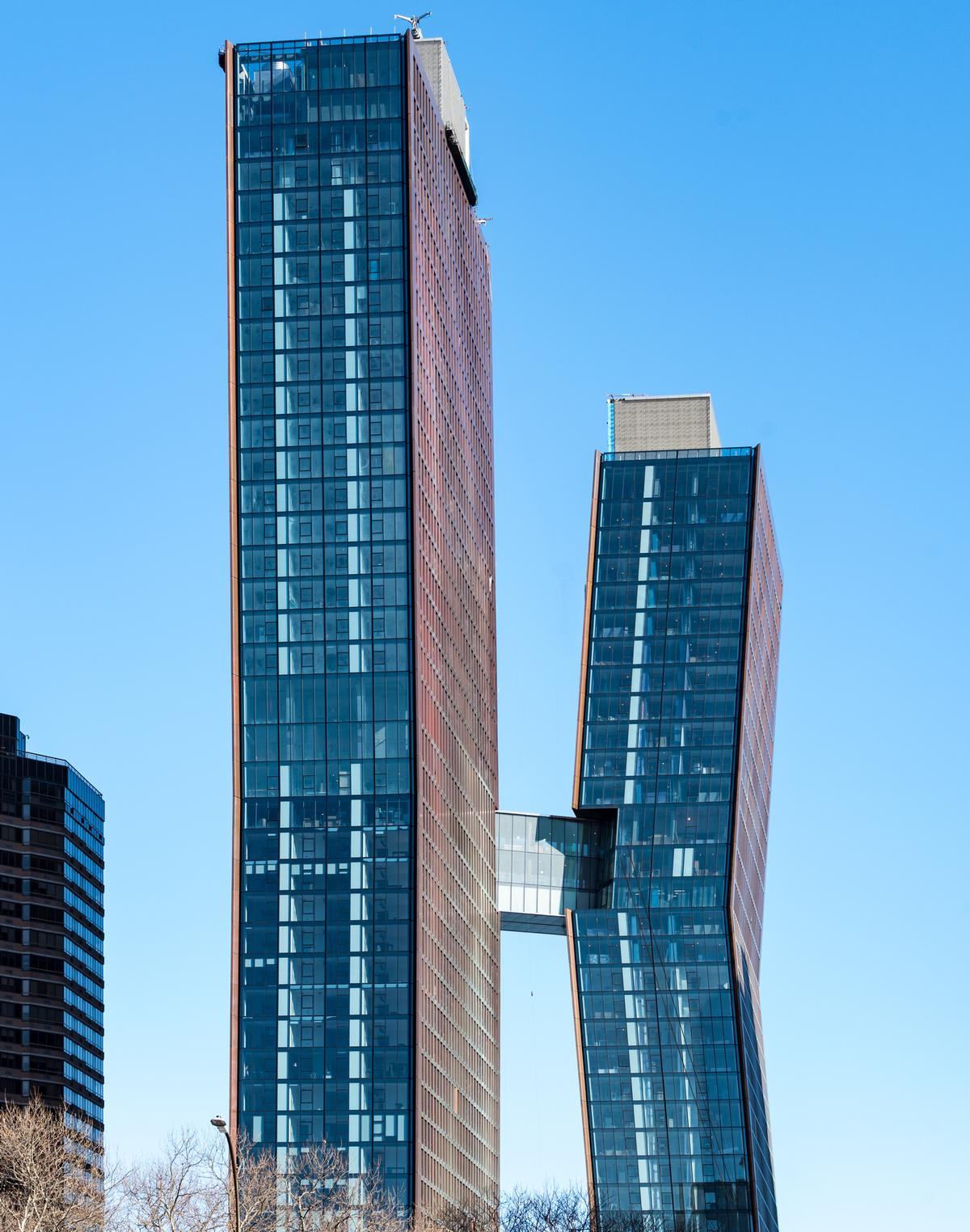 The soaring pair of copper-clad luxury rental towers are linked by a three-story skybridge 300ft in the air / JDS Development Group