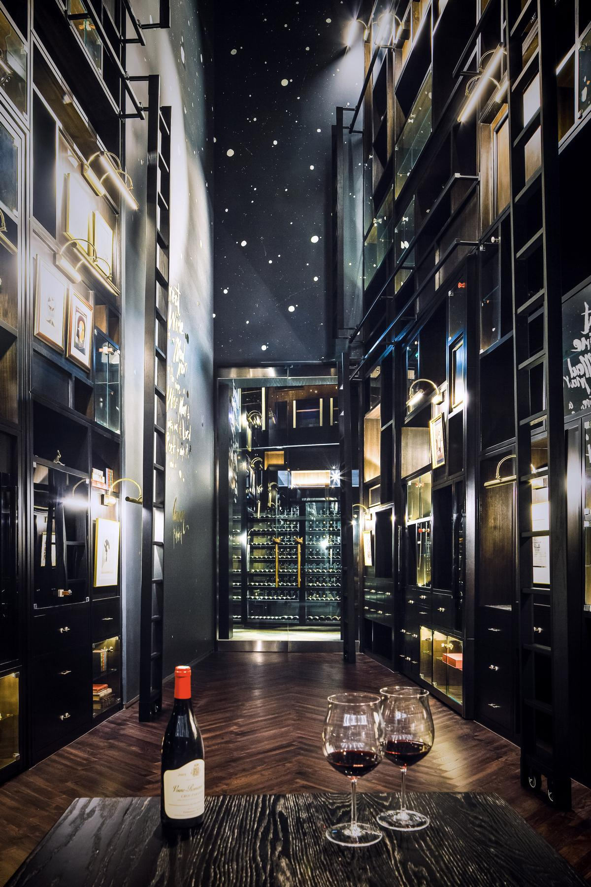At the heart of the restaurant is a 16m high wine wall, described by the designer as 'a marvel to behold'