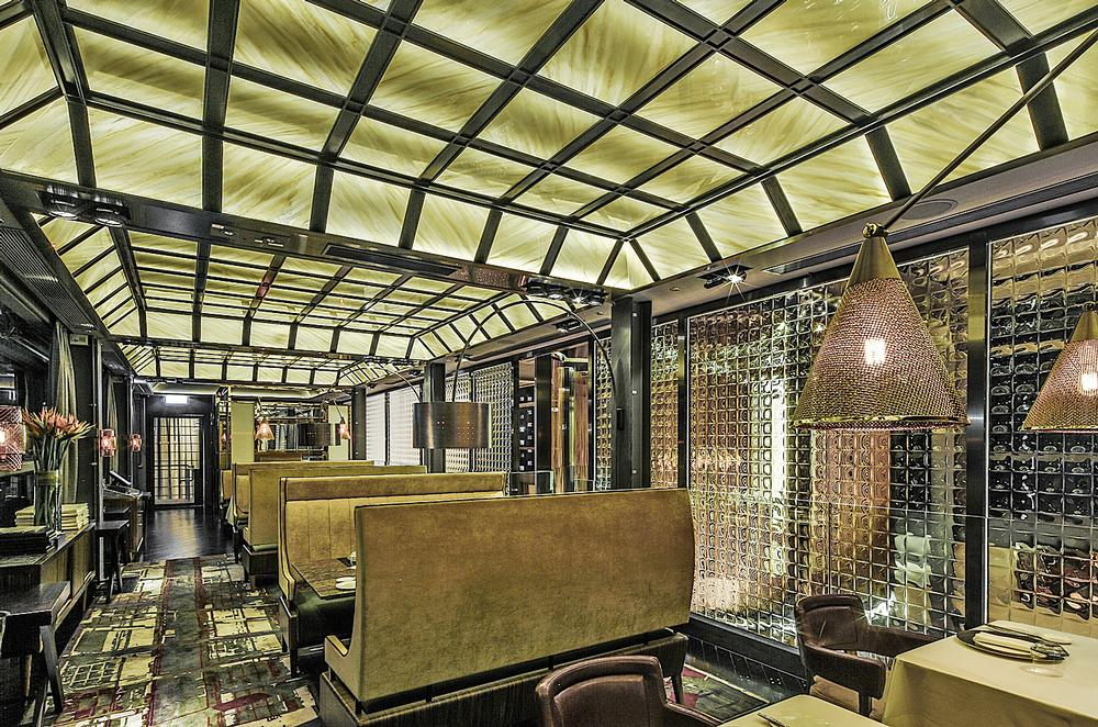 Mott 32 features a large dining area and five private rooms