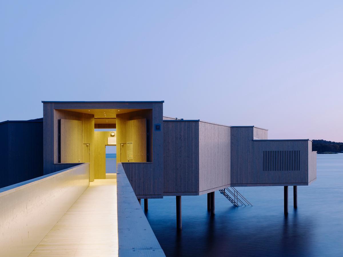 Designed by White Arkitekten, the SEK8m bath house is owned by Kallbadhusets Vänner