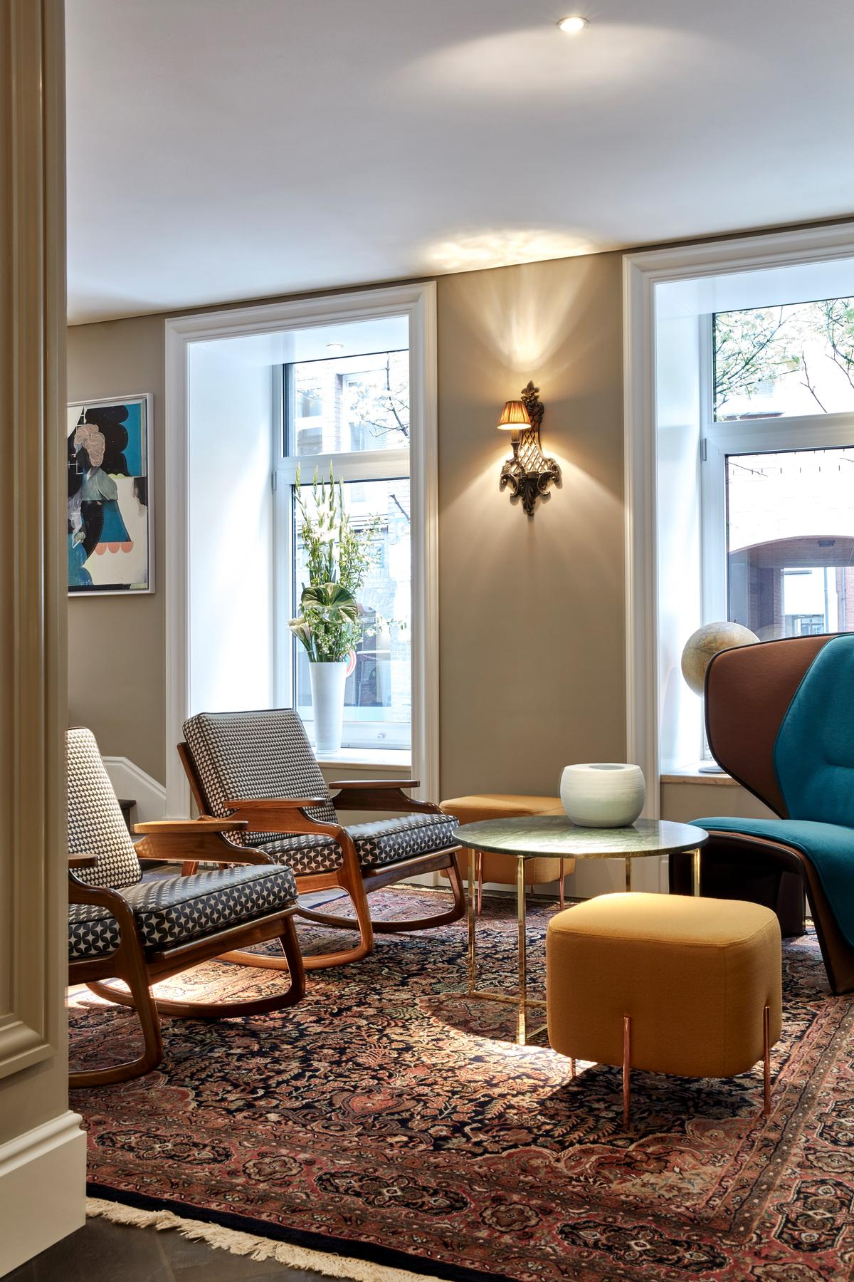 The hotel's guest rooms and side terraces look out at the café-lined waterways of the Nikolaifleet canal and the Altstadt Old Town beyond / Design Hotels