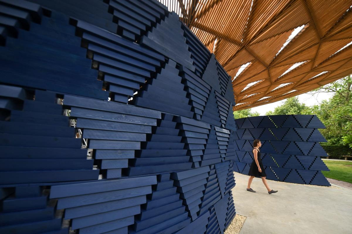 The structure's bright indigo walls – formed of inverted wooden triangles – are angled so as to let daylight flood in  / Victoria Jones/PA Images
