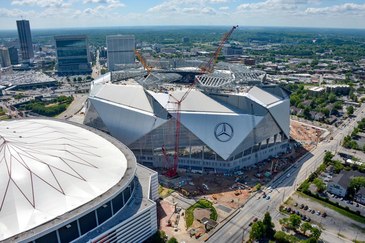 With a capacity of 83000 people and a size of 2 million sq for Who owns mercedes benz stadium