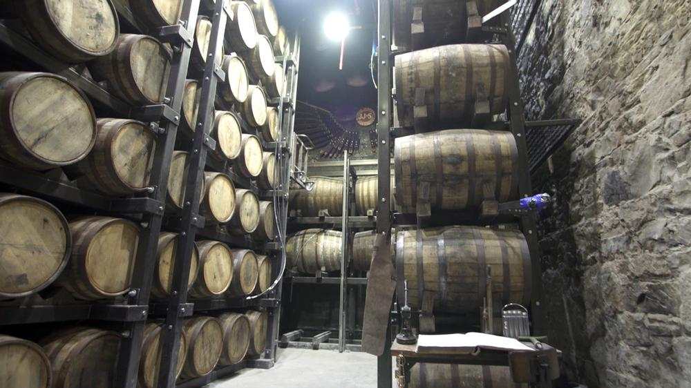 The tour leads to the Maturation Warehouse where guests can sample whiskey straight from the cask
