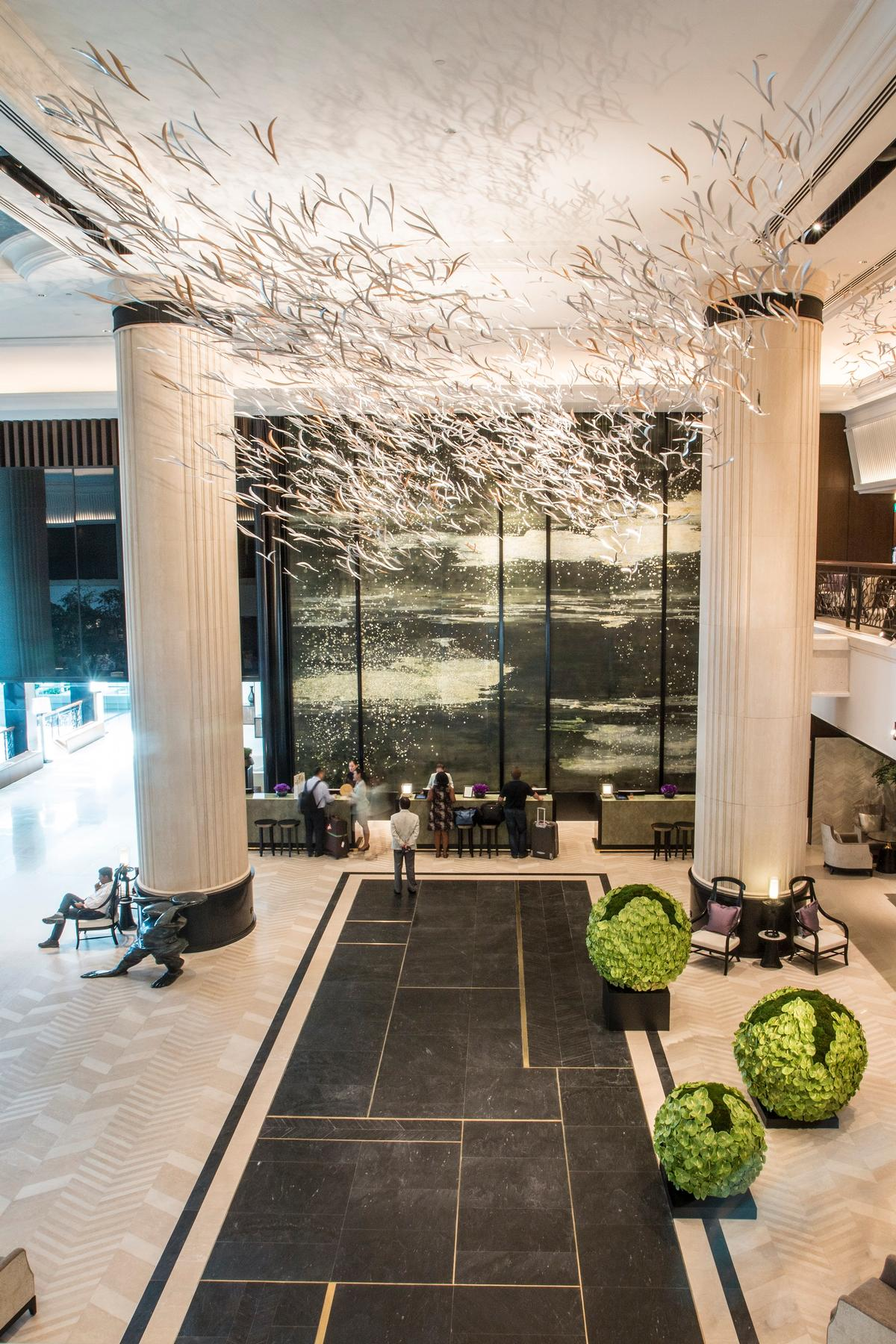 Renowned Japanese designer Hirotoshi Sawada has created a ceiling art installation formed of thousands of cascading stylised leaves / Shangri-La