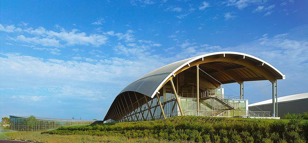 The architects have designed a sleek, simple building with a distinctive curved roof / PHOTO: ©Leo Torri