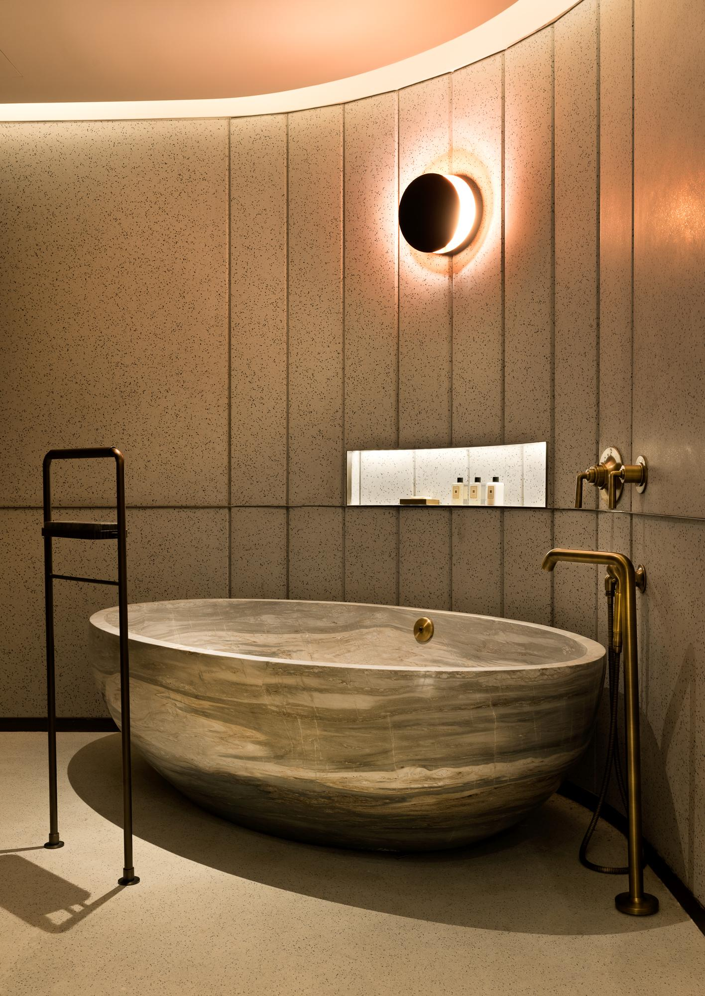 The suite's master bathroom has been built around a freestanding one piece marble Palissadro bathtub