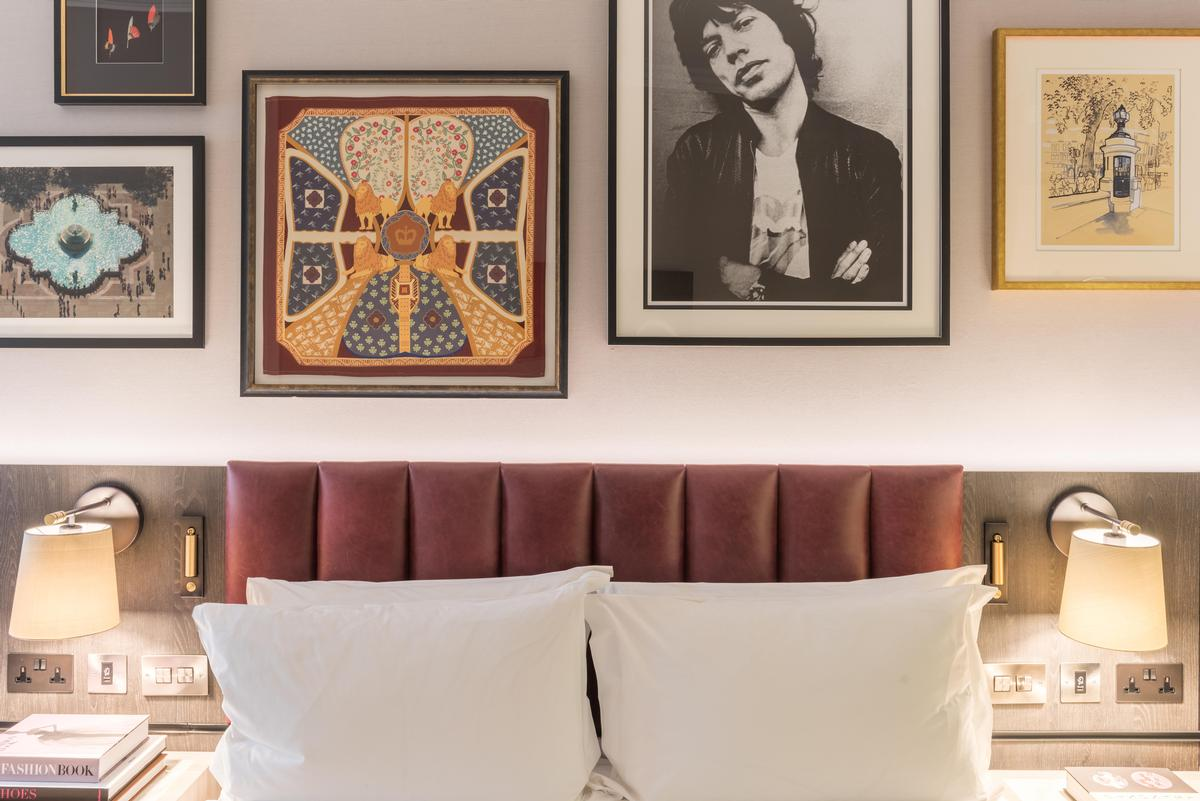 Pictures of London's music icons adorn the bedroom walls / Hilton