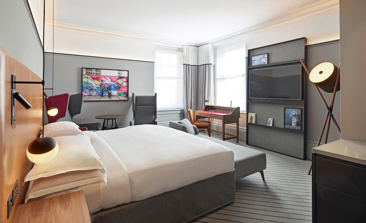 Each guest room has been designed in a residential style, with the existing timber panelling preserved but stained in a contemporary fashion / Andaz London Liverpool Street