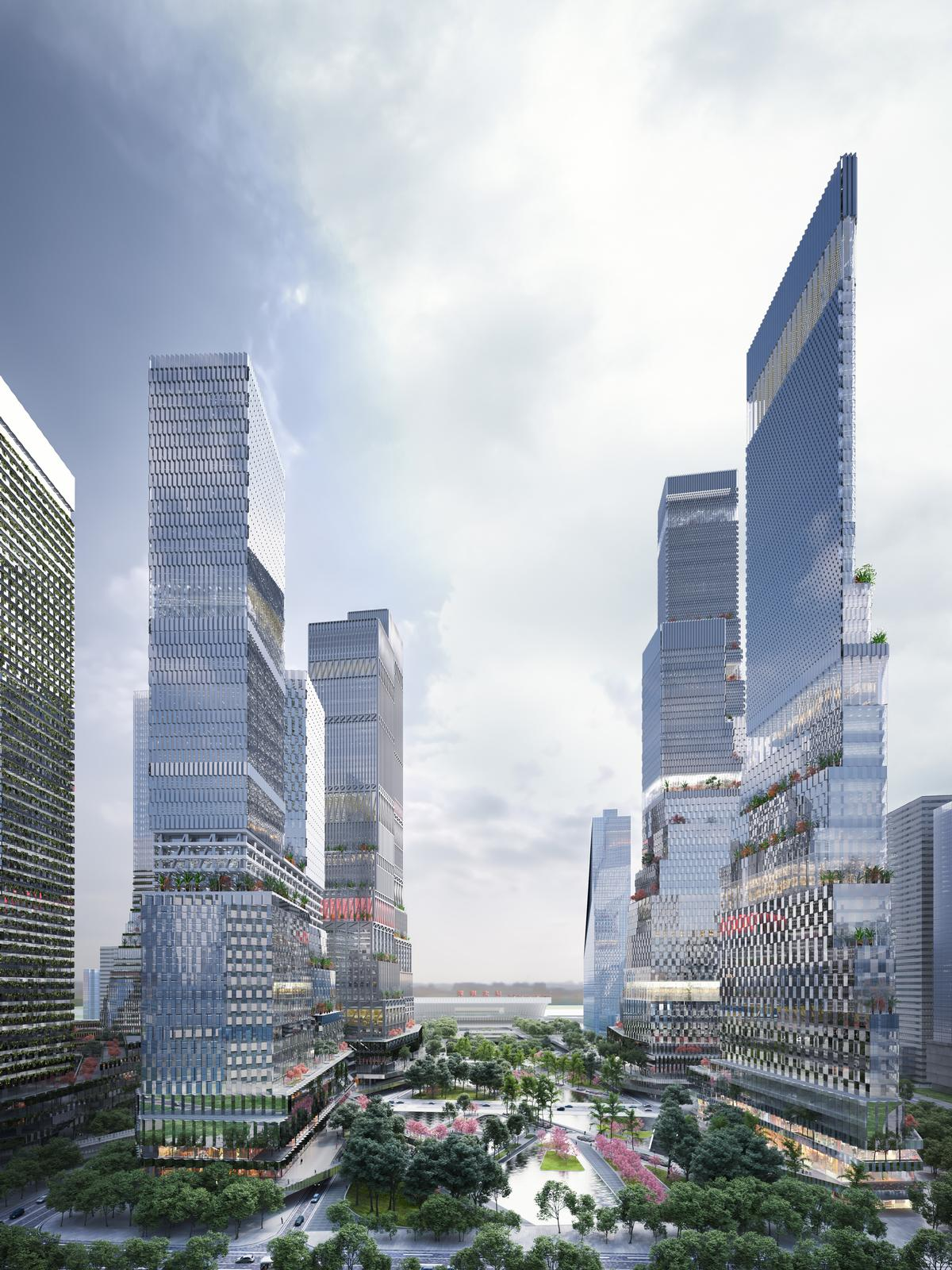 Twelve staggered skyscrapers, an elevated pedestrian network and a vast green urban park form the key elements of the 1.36 million sq m development / Mecanoo