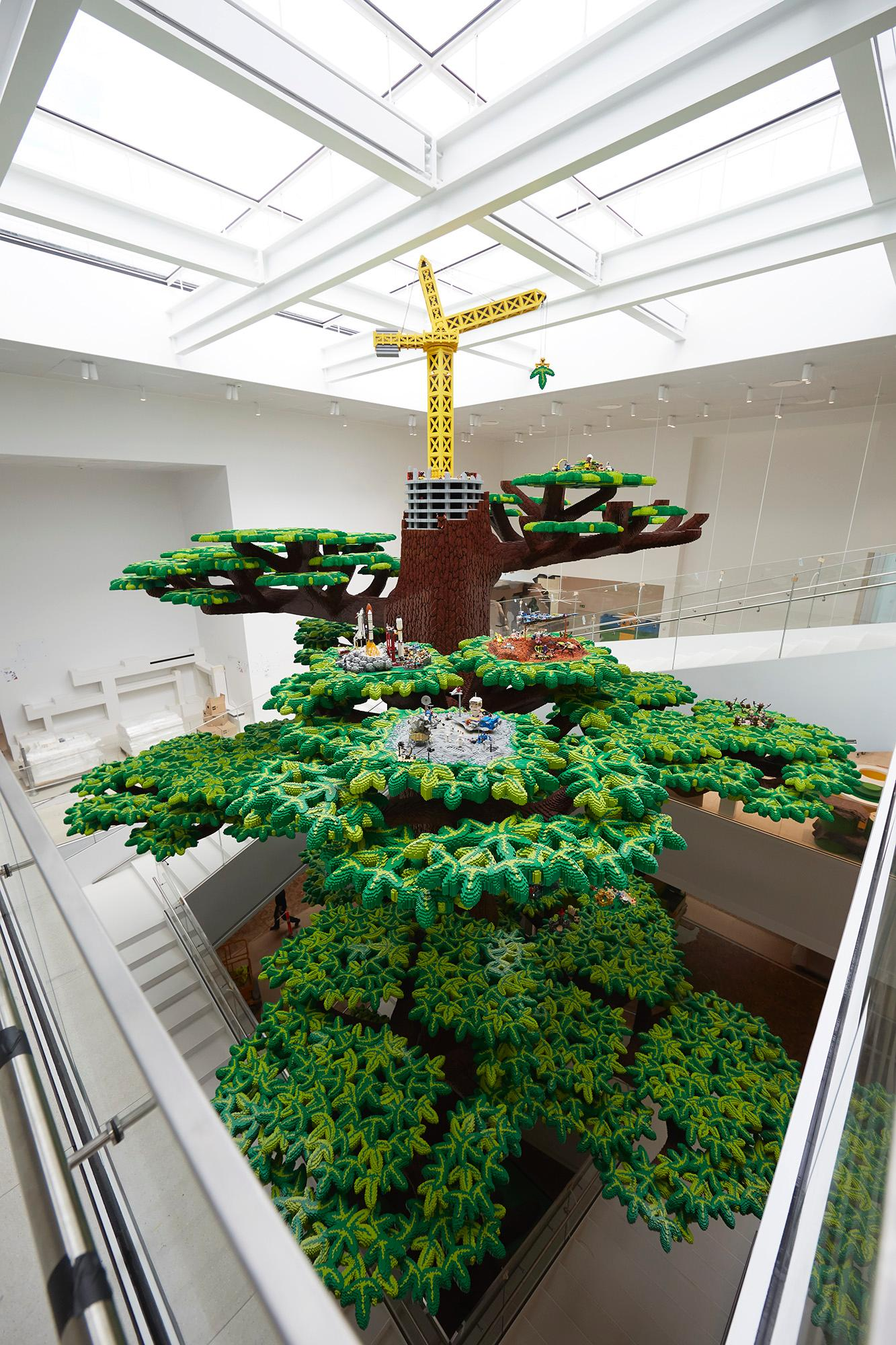 The building is conceptually anchored by a 15m tall Tree of Creativity built entirely from Lego / Lego Group