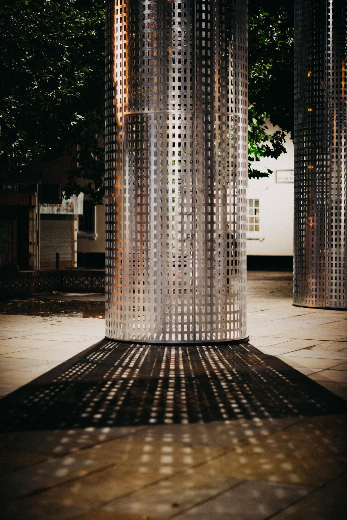 Perforations have been added across their frosted-like steel skin to 'create a delicate interplay of light and shadow across the interiors of each inhabited space' / Thomas Arran