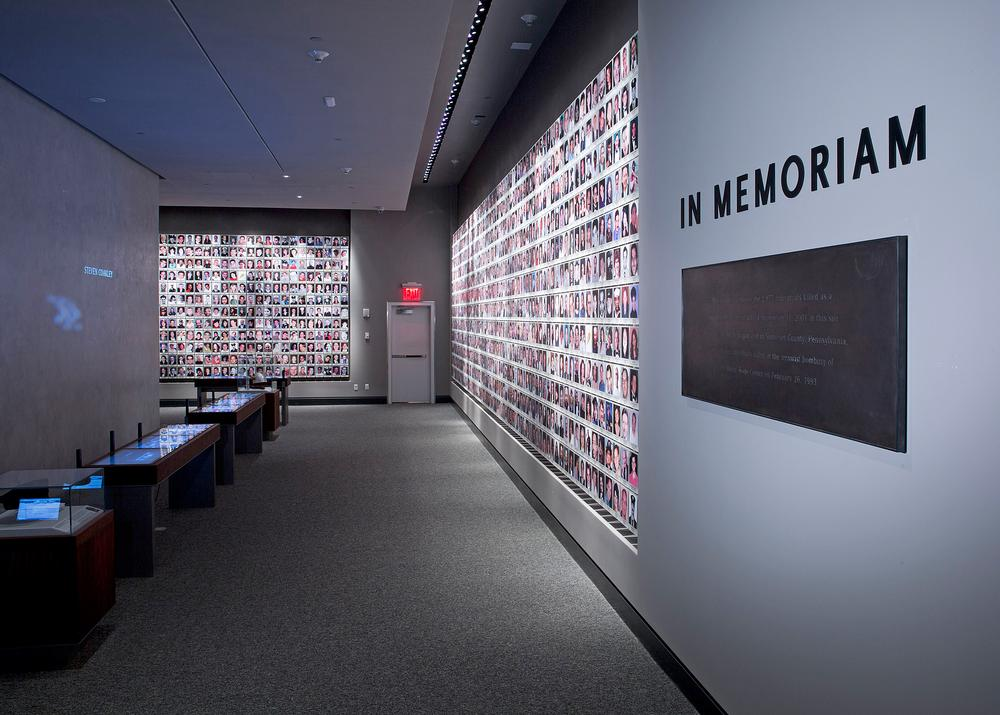 The Wall of Faces, part of the In Memoriam exhibition, communicates the scale of human loss to visitors / PHOTO: ©JIN LEE