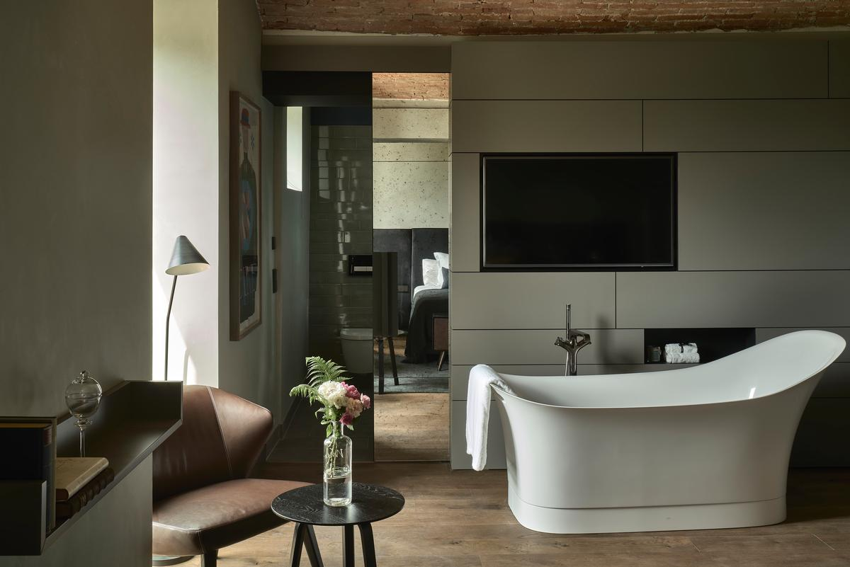 Tiled bathrooms, black leather headboards and distressed brown leather sofas feature in many rooms and suites / Design Hotels