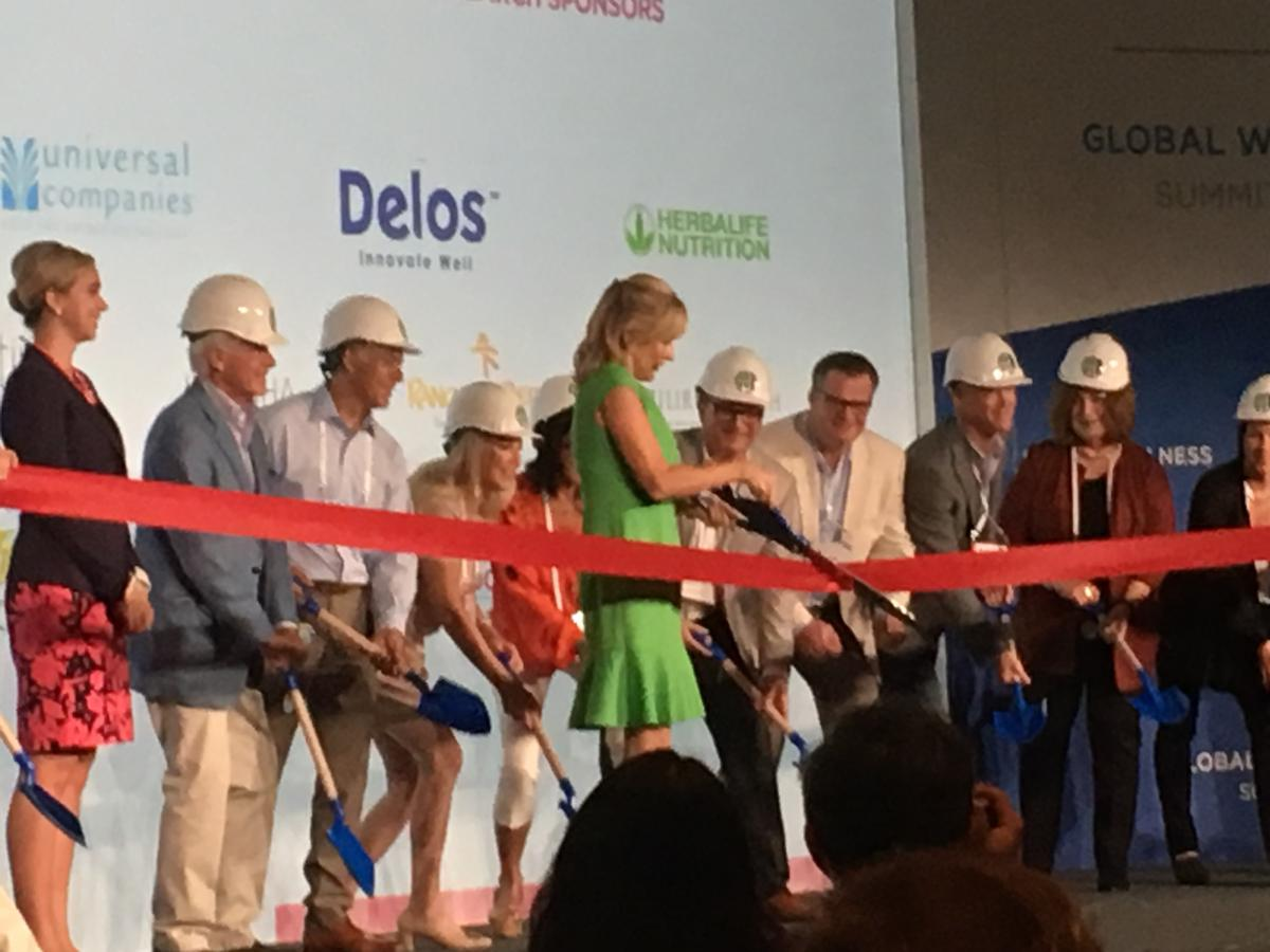 GWI chair Susie Ellis cuts the ribbon on the new research, as sponsors help with hard hats and shovels